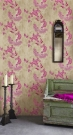 A room with two candle sticks, a mirror and a vintage cabinet featuring hot pink on tea stain wallpaper - Rockett St George