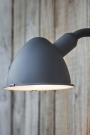 Close up of the Berkeley outdoor wall light in charcoal providing light