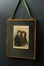 8x10 brass and glass picture frame with a black and white photo of laurel and hardy in it