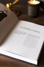 Lifestyle image of the All Black Everything book open with text on a coffee table