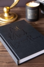 Lifestyle image of the All Black Everything book closed on a coffee table
