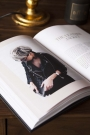 Lifestyle image of the All Black Everything book open with an image on a coffee table