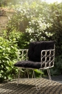 Lifestyle image of the front of the Bamboo Link Armchair With Black Noir Seat Cushion