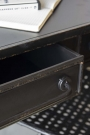Close-up image of an open drawer on the Black Metal Sideboard Desk