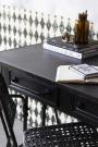 Close-up lifestyle image of the Black Metal Sideboard Desk