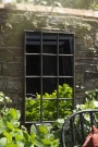 Lifestyle image of the Indoor Or Outdoor Crittall Mirror