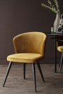 Front-on lifestyle image of the Golden Ochre Deco Velvet Dining Chair