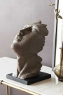 Lifestyle image of the large Distressed Stone Effect Resting Head Ornament
