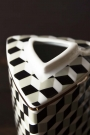 Close-up of the top of the short Geometric Monochrome Storage Jar with Gold Detail