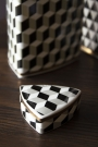 Close-up of the lid of the short Geometric Monochrome Storage Jar with Gold Detail