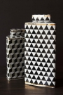 Lifestyle image of the short and tall Geometric Monochrome Storage Jar with Gold Detail