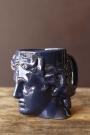 Side-on lifestyle image of the Greek Goddess Hestia Mug in blue