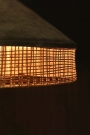 Close-up image of the rattan detail lit up on the Silver Grey Velvet & Rattan Pendant Ceiling Light