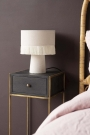 Close-up lifestyle image of the Sophos Single Drawer Bedside Table next to a bed with a lamp on top
