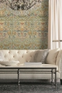 Lifestyle image of the powder Brocade wallpaper with a sofa and coffee table in front of it