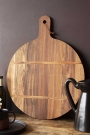 Lifestyle image of the Natural Acacia Round Chopping Board