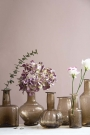 Lifestyle shot of all of the recycled glass vases