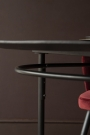 Side close-up image of the top of the Sungkai Wood Black Oval Dining Table