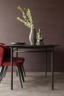 Front on lifestyle image of the Sungkai Wood Black Oval Dining Table