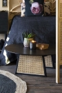 Lifestyle image of the Sungkai Woven Cane Round Coffee Table
