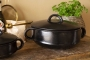 Wide angle lifestyle image of the Black Brown Terracotta Casserole Dish - Large