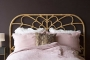 Full width lifestyle image of the Bloom Natural Rattan Headboard - Double Bed