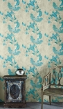 lifestyle image of Barneby Gates Paisley Wallpaper - Turquoise on Old Grey with distressed chair and black side table in front