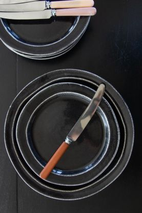 Lifestyle image of the Antique Black Dunes Stoneware Plate Collection