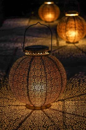Lifestyle image of the Antique Brass Moroccan Solar Lantern
