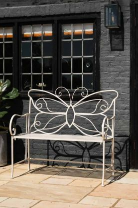 Lifestyle image of the Beautiful Butterfly Antique White Metal Bench