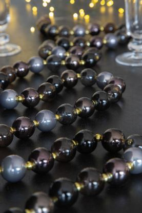 Image of the Black Glass Bauble Garland draped on the Christmas dinner table