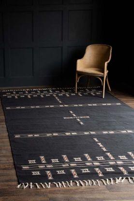 Lifestyle image of the Dark Grey Inka Cotton Rug