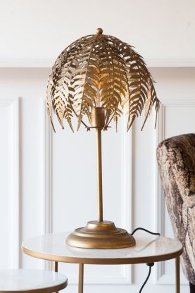 Lifestyle image of the Fern Leaf Palm Tree Style Table Lamp