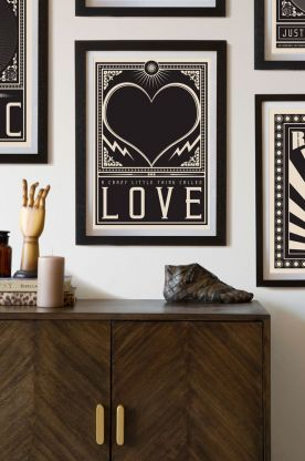 Lifestyle image of the Framed Crazy Little Thing Called Love Art Print hanging on the wall