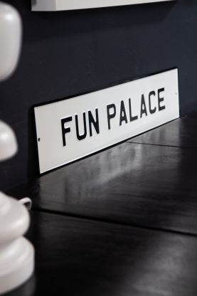 Angled image of the Fun Palace Metal Sign Wall Art