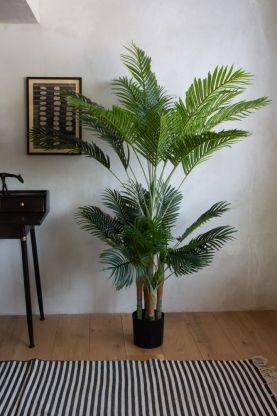 Lifestyle image of the Giant Faux Palm Tree