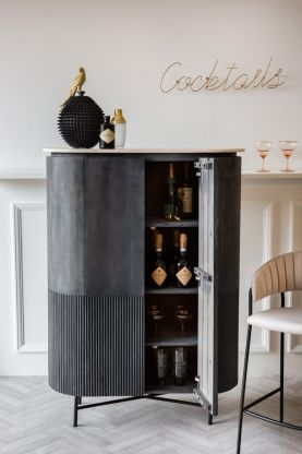 Lifestyle image of the Mango Wood & Marble Dark Oval Cabinet