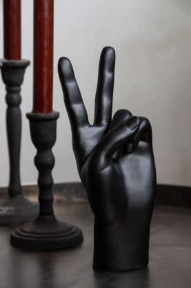 Lifestyle image of the Matt Black Peace Hand Display Ornament