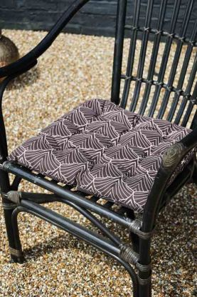 Image of the Patterned Seat Pad Cushion In Dark Brown on a chair
