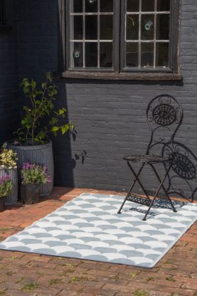 Lifestyle image of the Two-Tone Scallop Pattern Outdoor Garden Rug