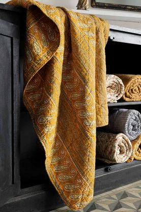 Lifestyle image of the Yellow Paisley & Floral Stripes Quilt