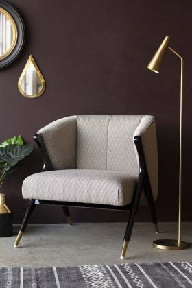 Lifestyle image of the Art Deco Style Armchair with gold floor lamp and mirrors on dark purple wall and grey floor with rug background