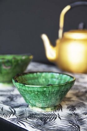 lifestyle image of Authentic Tamegroute Small Bowl - 11cm with other Tamegroute bowl and gold teapot in background n black and white table runner