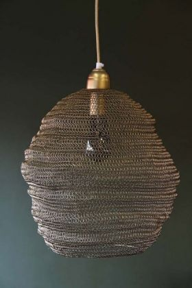 lifestyle image of Beehive Antique Bronze Chain Pendant Light turned off on dark wall background