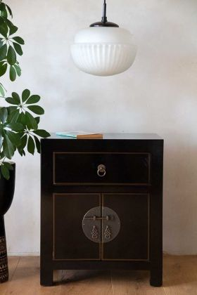 Front on lifestyle image of the Oriental Gloss Black Bedside Table