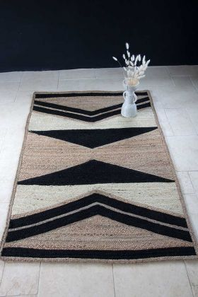 Lifestyle image of the Natural, Black & Ecru Chevron Jute Rug