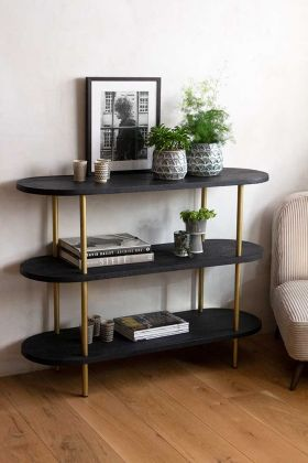 Lifestyle image of the Black Wood & Gold Leg Lozenge Shelving Console