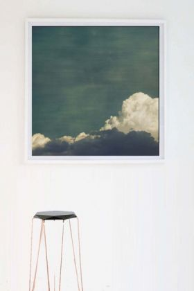 lifestyle image of Cloud Play II By JR Goodwin - Etching Paper Or Canvas with black and gold stool and white wall background