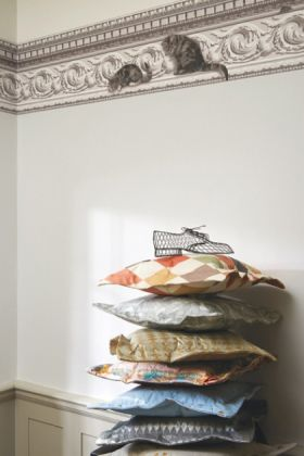 lifestyle image of Cole & Son Whimsical Collection - Paddy & Louis Border with pile of cushions