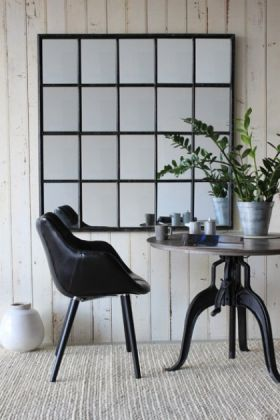 Large Square Windowpane Mirror with black chair and dining table plant on white flooring and pale wall background lifestyle image